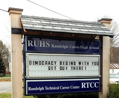 "saying ""democracy begins with you, get out there"" in from of local high school"