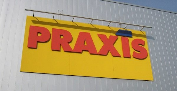 sign that says PRAXIS in big letters on the side of a building