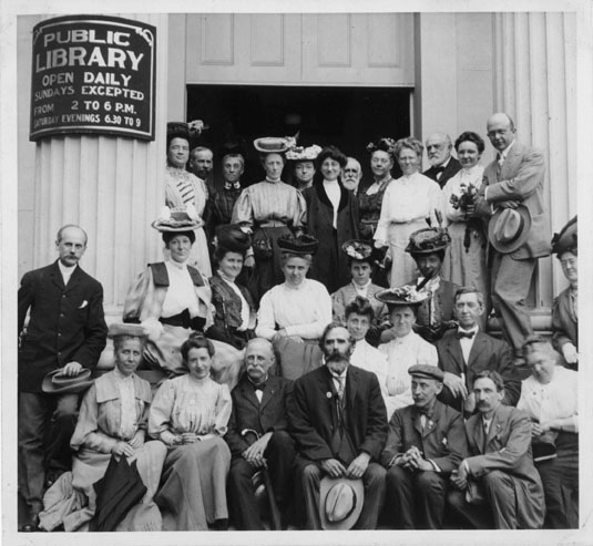 a group of librarians in front of the Natucket Public Library sometime in the early 19th century